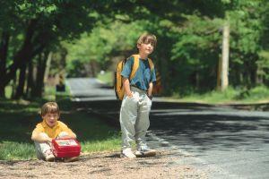 Boys waiting for school bus