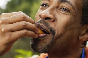 Close-up of man eating