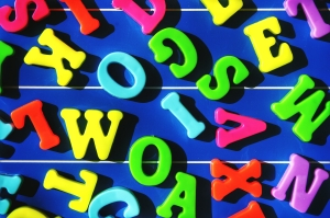 Directly Above Shot Of Colorful Alphabet On Blue Table