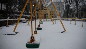 Japan, Tokyo Metropolis, Tama City, Snow covered swings in playground