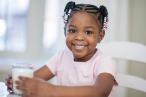 Little Girl Growing Strong Drinking Milk
