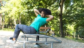Workout in park on sit-up bench
