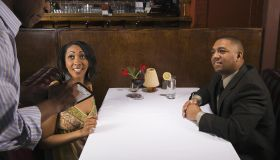 Couple ordering at fancy restaurant