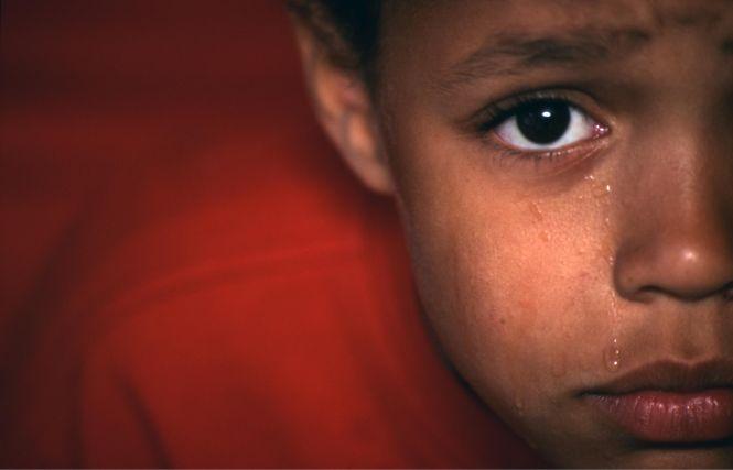 Close up of crying upset small boy,, UK