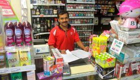 A cashier inside 7-Eleven.