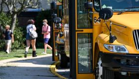 Buses wait outside Long Island high school at the end of first day of school in 2020
